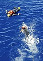 US Navy 110927-N-WJ771-091 Electronics Technician 3rd Class Jonathan A. Simmons swims toward a training dummy during a man overboard drill.jpg