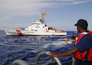 United States Coast Guard - A boatswain's mate watches from the side port door as Coast Guard Cutter ''Bertholf'''s Over-The-Horizon small boat departs to receive personnel from Coast Guard Cutter Chandeleur in 2008.