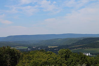 Columbia County, Pennsylvania - View of northern Columbia County, Pennsylvania from Kramer Hill Road in Fishing Creek Township. On the horizon (about 8-10 miles away) is North Mountain. The borough of Benton is in the center of the picture.