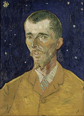 A closeup portrait of an intense young man well-dressed with suit and tie, facing to his right (the viewer's left), he has a moustache and goatee and he is standing in front of a starry sky in the background.