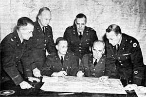 St. Clair Streett - Col. St. Clair Streett (at left) with Gen. Eisenhower in War Plans Division meeting, March 1942