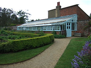 Climate-friendly gardening - Kitchen garden at Charles Darwin's home, Down House, Kent, showing greenhouse, waterbutt, box hedging and vegetable beds.