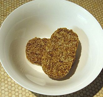 Weetabix - Two dry Weetabix in a bowl