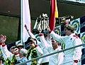 Winners Hurley Haywood, Mauro Baldi & Yannick Dalmas on the podium at the 1994 Le Mans (31933291606).jpg