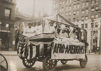 "This parade float displayed the word ""Afro-Americans"" in 1911. ""Afro-Americans"" float in Golden Potlatch parade, Seattle, July 1911 (MOHAI 5590).jpg"