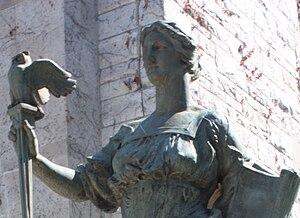 Standing Liberty quarter - MacNeil's statue Intellectual Development (detail shown) bears similar garb to Liberty on the Standing Liberty quarter.