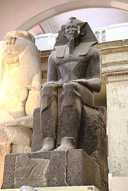 Granite statue of Pharaoh Imyremeshaw in the Egyptian Museum in Cairo