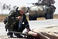 030402-M-3138H-007 - HM3 Christopher Pavicek from Escondido, CA provides aid to a wounded Iraqi soldier.jpg
