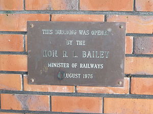 Minister of Railways (New Zealand) - Plaque next to main entrance of Hamilton Railway Station - opened by Hon Ron Bailey, 1975