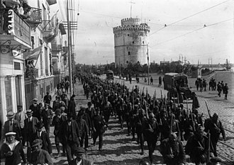 Provisional Government of National Defence - The 1st Battalion of the Army of National Defence marches before the White Tower on its way to the front.