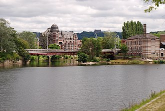 Chênée - The confluent streams of Vesdre and Ourthe. The red and white building behind the bridge is the old Hôtel de Ville (town hall)