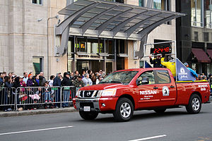 Mandarin Oriental Hotel Group - The entrance to Mandarin Oriental, Boston as a pace truck for the 2013 Boston Marathon passes by.