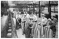 272-WOMEN FILLING SHELLS IN A BRITISH AMUNITION FACTORY.jpg