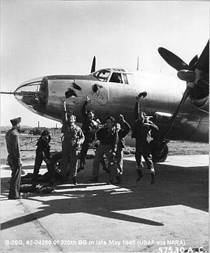 320th Air Expeditionary Wing - Martin B-26G-5-MA Marauder 42-34250 of the 320th Bomb Group crew celebrating the end of hostilities, May 1945