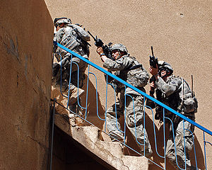 Soldiers from 1-30 Infantry, 2nd BCT, 3rd ID clear a house in Arab Jabour