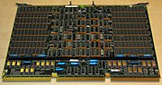 A four-megabyte RAM card measuring about 56 by 38 centimeters (twenty-two by fifteen inches); made for the VAX 8600 minicomputer (ca. 1986). Dual in-line package (DIP) Integrated circuits populate nearly the whole board; the RAM chips are the most common kind, and located in the rectangular areas to the left and right.