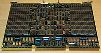 A four-megabyte RAM card measuring about twenty-two by fifteen inches (55.8 by 38.1 centimeters); made for the VAX 8600 minicomputer (circa 1986).  Dual in-line package (DIP)  Integrated circuits populate nearly the whole board; the RAM chips are in the majority located in the rectangular areas to the left and right.