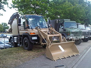 Backhoe loader - Modern Unimog as a backhoe loader