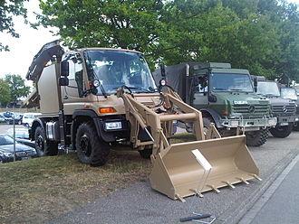 Backhoe loader - Modern Unimog as a backhoe loader