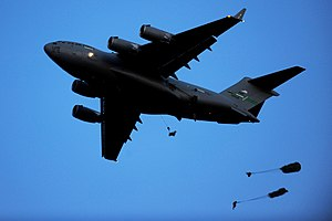 8th Airlift Squadron - 8th Airlift Squadron C-17A Globemaster III 90-0535 drops paratroopers from the 82d Airborne Division into a drop zone during a Joint Forcible Entry Exercise at Fort Bragg, North Carolina on 28 April 2010