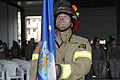 A U.S. Air Force firefighter with the 31st Civil Engineer Squadron holds the U.S. Air Force flag during a 9-11 remembrance ceremony at Aviano Air Base, Italy, Sept 120911-F-DN643-046.jpg