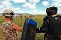 A U.S. Marine, left, and a member of the Mongolian Armed Forces prepare to role-play as aggressors during a pepper spray qualification course as part of the Non-Lethal Weapons Executive Seminar (NOLES) 2013 130821-M-MG222-009.jpg
