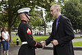 A U.S. Marine corporal, left, greets honorary Marine Daran Wankum following a wreath laying ceremony at the Marine Corps War Memorial in Arlington, Va, June 13, 2013 130613-M-KS211-021.jpg