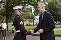 A U.S. Marine corporal, left, greets honorary Marine Daran Wankum following a wreath laying ceremony at the Marine Corps War Memorial in Arlington, Va, June 13, 2013 130613-M-KS211-021.jpg