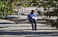 A boy sits at the Pentagon Memorial Sept 120911-D-NI589-162.jpg