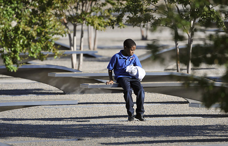File:A boy sits at the Pentagon Memorial Sept 120911-D-NI589-162.jpg