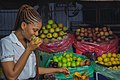 A lady's happy moment with apples in Owerri, Imo State.jpg