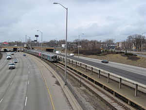 Kostner station (CTA Congress Line) - The abandoned platform at Kostner with a train approaching in January 2010