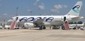 Tirana International Airport Nënë Tereza - Adria Airways Airbus A319 in Tirana