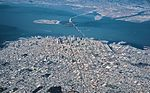Aerial view of downtown San Francisco, the Bay Bridge, Treasure Island, and Oakland.jpg