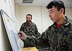 Afghan Air Force airman writes during literacy training at Kabul International Airport, October 31, 2011.jpg