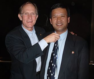 Peter Agre - Peter Agre in 2009 presenting his Johns Hopkins necktie to the Vice President of the DPRK State Academy of Science. The tie worn by Agre during his 2003 Nobel lecture in Stockholm is to be presented to the first DPRK scientist who wins a Nobel Prize.