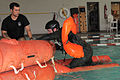 Airmen get a refresher in water survival training 150105-F-OF524-384.jpg