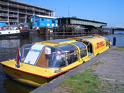 DHL boat in Amsterdam, carrying DHL bicycles aboard.