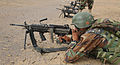 An Afghan National Army commando with the 1st Tolai, 3rd Special Operations Kandak fires an M249 light machine gun during a training exercise in the Dand district, Kandahar province, Afghanistan, May 25, 2013 130525-A-QS703-071.jpg