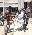 An elderly woman being carried at a polling booth after casting her vote, during the 7th Phase of General Elections-2014, at Uluberia Parliamentary Constituency, West Bengal on April 30, 2014.jpg