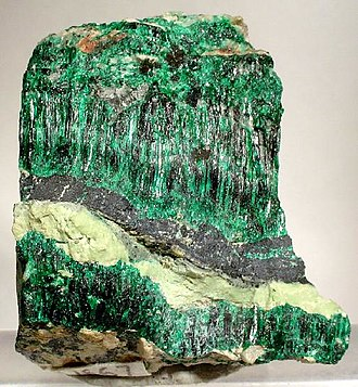Antlerite - A vein of acicular, green antlerite crystals from Chuquicamata, Chile (dimensions: 3.5 x 3.4 x 1.8 cm)