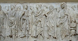 Flamen - Flamines, distinguished by their pointed headdress, as part of a procession on the Augustan Altar of Peace