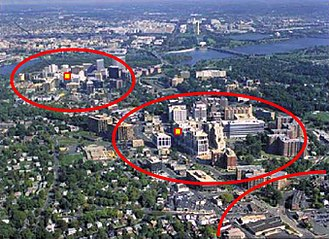 Land-use planning - Aerial view of Rosslyn-Ballston corridor in Arlington, Virginia. High density, mixed use development is concentrated within ¼–½ mile from the Rosslyn, Court House and Clarendon Washington Metro stations (shown in red), with limited density outside that area.  This photograph is taken from the United States Environmental Protection Agency  website describing Arlington's award for overall excellence in smart growth in 2002 — the first ever granted by the agency.