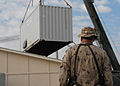 Armored crane moves shipping containers while expanding the ROLE 3 Hospital on Kandahar Airport -d.jpg