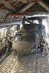 Army, Air National Guard members load HC-60 Black Hawk on board a C-17 130410-Z-GK473-097.jpg