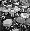 At the Races, Pimlico racetrack, near Baltimore, Maryland. Outdoor diner sitting under beach umbrellas, May 1943. - Flickr - polkbritton.jpg