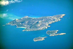 Cat Island (Tasmania) - An aerial photo of Cat Island, bottom right; with the much larger Babel Island pictured in the background. Storehouse Island is pictured bottom centre.