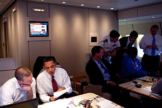 Jon Favreau (speechwriter) - President Barack Obama works with Jon Favreau on the President's Normandy speech aboard Air Force One en route to Paris on June 5, 2009.