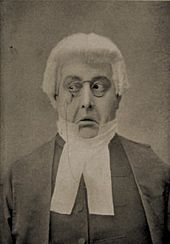 A sepia photo of the face of an actor, portraying the judge with an exaggerated expression of distaste