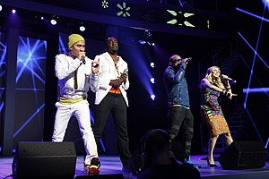 The Black Eyed Peas performing at a Walmart Shareholders' Meeting in 2011 (from left) Taboo, will.i.am, apl.de.ap, Fergie